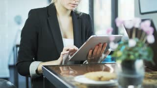 Business People Are Using Tablet and a Laptop