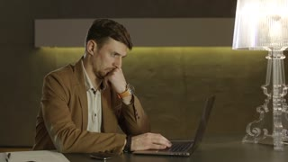 Businessman focused on the screen of his laptop computer