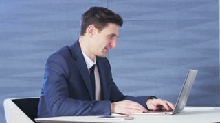 Businessman looking with interest at a computer