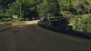 Car Goes Through an Old Bridge in a Amazing Scenary in Madeira