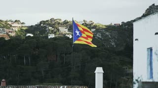 Catalunya flag. Hills and a house in the surrounding