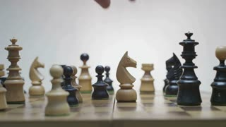 Checkmate. White horse beats black king. End of the game.