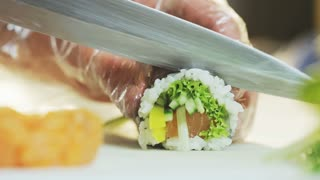 Cutting Sushi Roll Seen From the Side