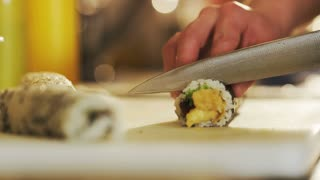Cutting Sushi Rolls Seen From the Side