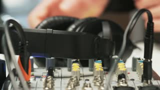 Disc Jockey Taking Headphones And Listening to Music