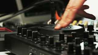 Disc Jockey's Hands and Face While He Changes Settings of the Sound Control System