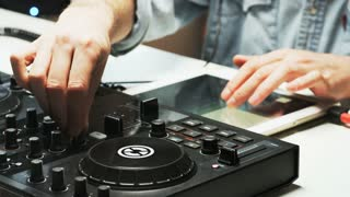 Disc Jockey's Hands While He Changes Settings of the Sound Control System