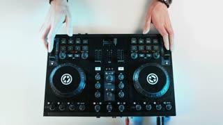 Disc Jockey's Hands While He Uses DJ Mixer