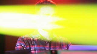 DJ Sitting in the Beam of Acid Yellow Light