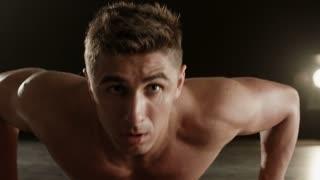 Healthy young man doing push-ups