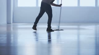 Man Cleaning the Floor in an Exercise Gym