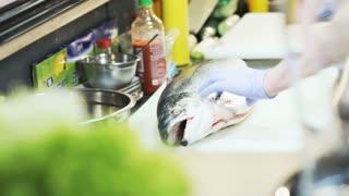 Man Cutting Salmon's Head