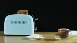 Man Turns the Toaster On