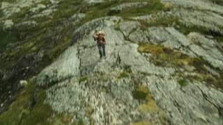 Man Walking in the Mountains. Drone shot. Norway
