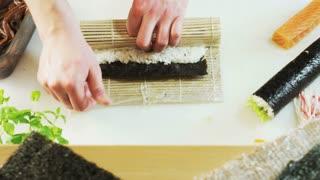 Moistening Nori and Making Sushi Rolls