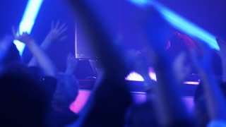 People Waving Their Hands During a Party