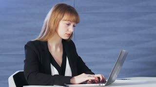 Pretty young woman bored after work with computer