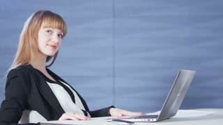 Pretty Young Woman Excited While Using a Computer