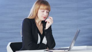Pretty Young Woman Yawns During Work