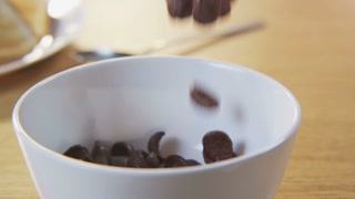 Putting Chocolate Flakes Into a Bowl