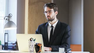 Sad Young Businessman During Work