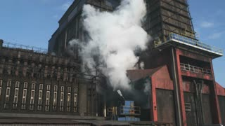 Smoke Out of The Industrial Chimney. Camera Moving Up