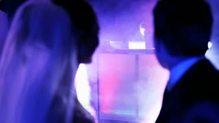The Young Couple in a Nightclub Looking at the DJ