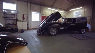 Three Classic Cars in a Workshop. Camera Moving Left. Cars Ready to Restore