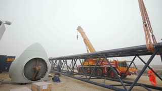 Truck-Mounted Crane Moving Further From the Camera