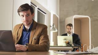 Two Businessmen Focused on Work