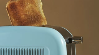 Two Loaves of Bread Jumping Out of an Electric Toaster