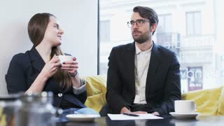 Two Young Business People During a Nice Conversation