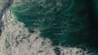 4K Drone footage of Breaking Waves on Rocky Coastline.