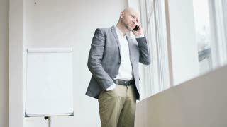 Bald Businessman Ending a Phone Call