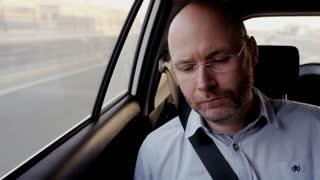 Bald Middle-Aged Businessman Feeling Sleepy in the Car