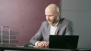 Bald Middle-Aged Businessman Taking Off Jacket
