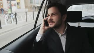 Businessman Having a Nice Phone Call. Car is Immobile