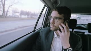 Businessman Holding Mobile Phone Against His Ear