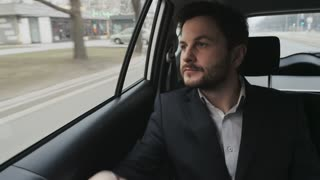 Businessman in the Car Dialing a Phone Number