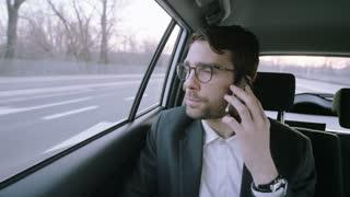 Businessman Raising His Finger During a Phone Call