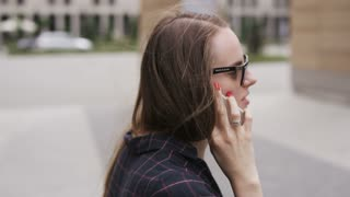 Businesswoman Having a Phone Call While Outdoors