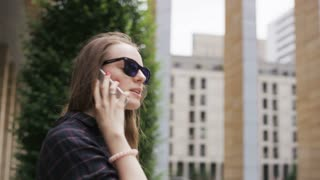 Businesswoman Smiling During a Phone Call Outdoors