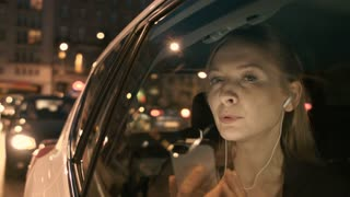 Businesswoman Talking on the Phone in a Car. The Car Stops
