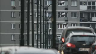 Cars Moving Slowly in a Traffic Jam. Block of Flats