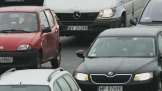 Cars Moving Slowly in a Traffic Jam