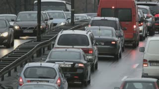 Cars Moving Slowly in Opposite Directions. Traffic Jam