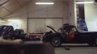 Classic Cars in a Workshop. Cars Ready to Restore