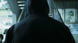 Frustrated Hooded Young Man Walking Upstairs