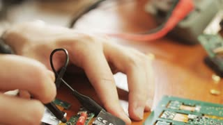 Hands of a Young Man Doing Repair of the Computer Chip