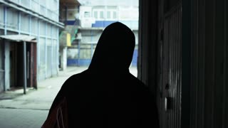 Hooded Young Man Walking Abandoned Street